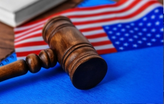 American flag and courtroom gavel